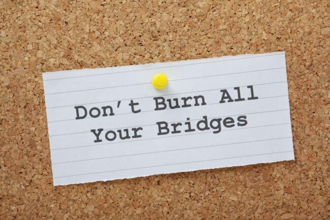 How can I look for a job without burning bridges with my current employer?